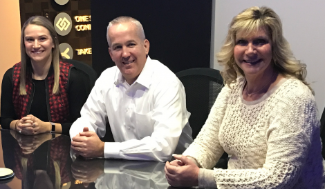 3 McGohan Brabender Employees sitting and smiling towards camera